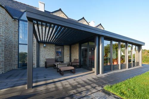 Pergola aluminium bioclimatique à lames orientables